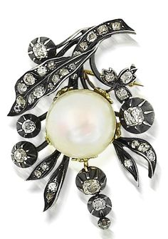 A pearl and diamond brooch Of floral spray design, the foliage set throughout with old mine-cut diamonds, the flowerhead set with a natural blister pearl, measuring approximately 17.26mm, mounted in silver on gold, length 4cm.
