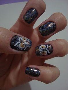 Owl nail art.