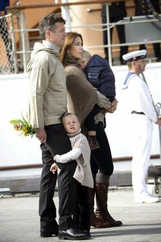 MYROYALSHOLLYWOOD FASHİON: Danish Crown Princely Family visit Paamiut, Greenland, August 4, 2014-Princess Josephine with a grip on dad Crown Prince Frederik's leg and Prince Vincent in his mother Crown Princess Mary's arms