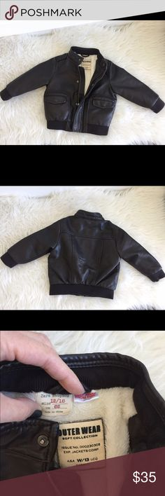 Zara Baby Boy Bomber Jacket Zara Baby Boy Bomber Jacket, dark brown faux leather, size 12/18 months. Adorable!! Worn once for a photo shoot! Does have a small on-seam hole on inside lining (pictured). Could easily be stitched! Zara Jackets & Coats Puffers