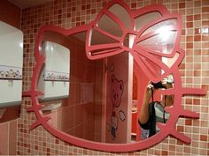 hello kitty mirror wall.  This is so creepy but I love it.