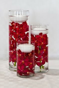 Red Flowers and Candle Centerpieces: The Best Ways to Use Red As the Theme of Your Wedding. http://memorablewedding.blogspot.com/2014/05/red-wedding-theme-best-ways-to-use-red.html