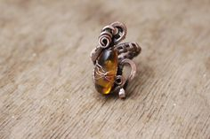 """Ring """"Honey"""" made in the technique of wire wrap with amber : Bague par cuivre-bijoux"""