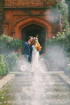 Wedding Photography, Bride and groom kiss, fountain, Woodhall Manor