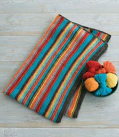 For an easy knit that makes a big impact, work bright, multicolored stripes in garter stitch.