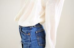denim high-waisted jeans and a white blouse | tarafirma