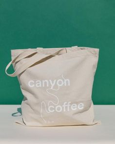 Our classic Canyon Coffee tote bags! Natural, quality canvas with our Canyon Coffee logo screen-printed in white. Product details: - Reinforced at stress points - W x H - handles Coffee Logo, Screen Printing, Classic, Shopping, Coffee Company, Tote Bags, Stress, Printed, Canvas