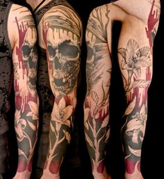 Skull and flower Full Sleeve Tattoo. Really love the black/red fade on this!