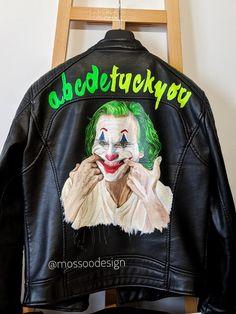 JOKER Jacket by @mossoodesign. Put on a happy face 🃏 #jokerjacket #thejoker #jokermovie #jokerart #putonahappyface #acbdefuckyou #joaquinphoenix Joker Jacket, Painted Leather Jacket, Joker Art, Leather Jackets, Put On, Jokes, Hand Painted, Smile, Sweatshirts