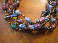 Bright multicolored paper bead with gold glass by MyScarfBoutique