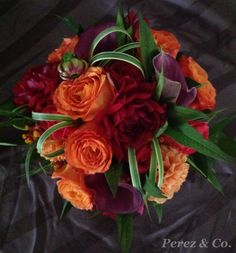 Fall is here and all it's beautiful colours! Rich Reds, Oranges And Purples make beautiful fall Wedding bouquets - By Perez & Co