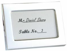 The Knot store.  Silver frames - place card holders.