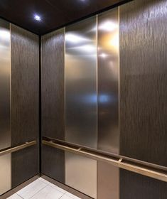 LEVELe-101 Elevator Interior; Capture panels in Bonded Bronze with Dark Patina and Grass pattern, Fused White Gold with Linen finish, and Fused Nickel Bronze with Linen finish; handrail panel and base in Fused Nickel Bronze with Sandstone finish; Rectangular handrails in Satin Bronze at Hilton Austin, Austin, Texas Lobby Interior, Interior Design, Elevator Design, Grass Pattern, Elevator Lobby, Bench Designs, Hotel S, Austin Texas, Home Decor Furniture