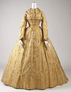 1865-67 day dress in silk. note the overlaid patterns on the brocade and the abstract looking flowers on the fabric design.