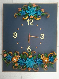 Floral quilling on a clock - by: Unknown quiller