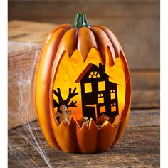Lighted Faux Carved Pumpkin with Haunted House | Decorative Accents