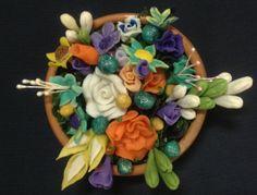Dough flower arranged in pot by DeraTrustShop on Etsy, $25.00