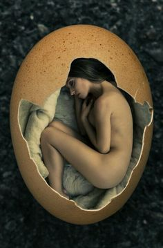 This is a peaceful photo composition in which a woman is sleeping inside of an egg like a newborn chick. I love how harmonious the color palette is and the overall round shape is very pleasing to the eye.