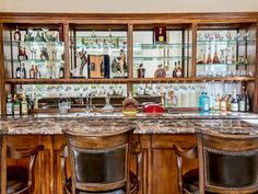 Situated in the family room, this custom designed wine bar with wine refrigerator is ready to host gatherings both small and large. 3840 Winford Dr | Mulholland Park