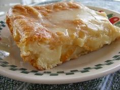 Cheese Danish - Ingredients: 2 cans ready to use refrigerated crescent rolls 2 8-ounce packages cream cheese 1 cup sugar 1 teaspoon vanilla extract 1 egg 1 egg white Glaze: 1/2 cup powdered sugar 2 Tablespoons milk 1/2 teaspoon vanilla extract Method: Preheat oven to 350* degrees and grease a 13X9-inch baking pan. Lay a pack of crescent rolls in the pan and pinch the openings together. Beat the cream cheese, sugar, vanilla, and egg together until smooth
