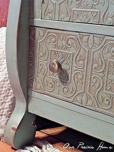 paintable textured wallpaper on furniture... LOVE
