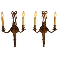 A fantastic pair of double-arm wall sconces. Made in France during the 1930s, the sconces feature solid bronze with great design.