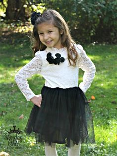 Long sleeve lace dress with tulle skirt. Necklace is detachable.