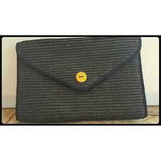 Vintage Almondo Straw Clutch OBO 1980's Vintage Almondo Black Straw Clutch  Large button snap in working condition. Like new. Almondo Bags Clutches & Wristlets