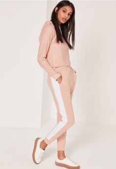 Nail the laid back look with these pink joggers, with contrasting white striped detailing to each side and comfy elasticated waistband.