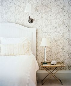 seaside-inspired bedroom in westhampton; driftwood grey, bits of gold, and a crisp white bed.