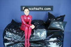 latex bedding - black / metallic pewter , with metallic red latex catsuit