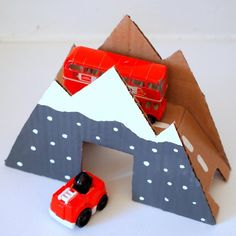 This super cute bridge looks like a mountain.  Make it for the transportation-loving little person in your life.
