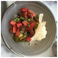 Watermelon salad, with whipped goats feta and heirloom tomatoes.