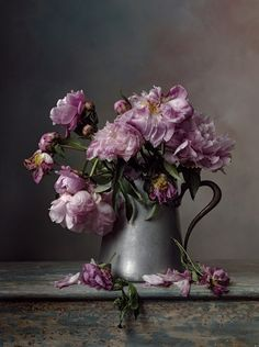 "Christopher Broadbent: title unknown [purple peonies]; oils on canvas.  ""Exquisite painting in lilacs and gray, of peonies in disarray as they enter their last stage of life. Wonderful composition and palette! I even admire the rendering of the distressed turquoise wood console upon which the pitcher sits!"" ~js"
