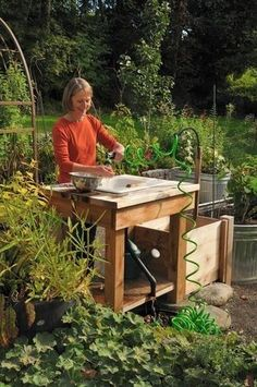 Wash Your Harvested Veggies outside with a sink that drains in the garden. This way the soil is returned and you water the garden.