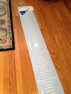 Tutorial and a free cut file for making a growth ruler chart using a Silhouette die cut machine to cute the marks and numbers.