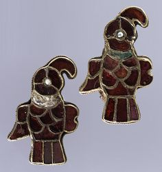 Pair of Bird-Shaped Brooches, 550–600 Frankish. Gold sheet, cloisonné cells inset with garnets, glass, and pearl, garnets backed with patterned foil.