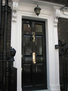 High gloss black door with glass top panel + brass hardware