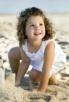 Girl building sandcastle on the beach