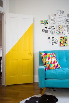 Paint your door on a diagonal with a bright, cheery hue.