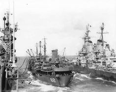 Battleship USS Iowa and carrier USS Shangri-La receiving fuel from oiler USS Cahaba, 8 Jul 1945