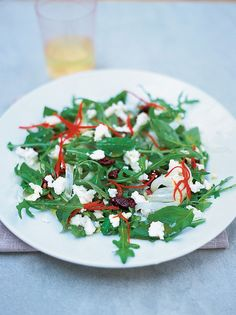 herb salad with goat's cheese | Jamie Oliver | Chop marjoram leaves, or pound in pestle and mortar. Put in a bowl with a tbsp olive oil and pinch of pepper. Rub this mixture all over the goats' cheese and bake in the oven 200C for around 10 to 15 minutes until nice and golden.  Toss the rocket, fennel, olives and lemon basil together in a bowl. Dress your salad with 6 tbsp of EVOO and half lemon, season. sprinkle crumbled goat's cheese and sliced chilli ... fantastic!