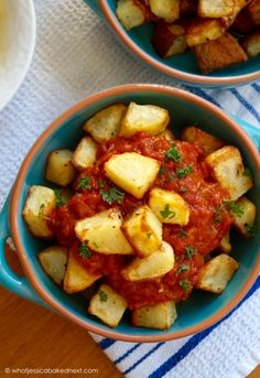 Patatas Bravas - crispy baked cubes of potato in spicy tomato sauce. So tasty and easy to make! A great recipe for a tapas night!