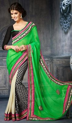 Black, cream and green embroidered georgette sari is perfect for evening party requirement. Sari is ornamented with woven lace, silk thread embroidered border, foliage inspired block print and scattered embroidered appliqued motifs which makes you center of attraction of everybody's eyes. Sari comes with contrast black raw silk stitched blouse as shown in the picture. #NewPatternTraditionalSarees