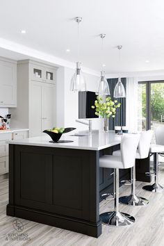 Classic in both function and form, this kitchen will fit happily into any sized space. The shaker door with v-groove makes an impressive statement with its simple detailing and selection of accompanying designer accessories. Interior, Living Brand, Kitchen Trends, Bespoke Kitchens, Shop Chair, Kitchen Decor, Kitchen, New Kitchen, Traditional Kitchen