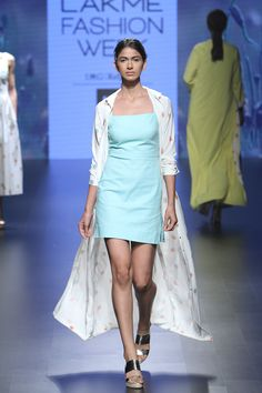 Day 3 - With a playful take on nerdy fashion, Nishka Lulla stayed true to safe pastels and easy separates. Flowerpot prints dominated the peach and blue colour palette. Crop tops and palazzos were layered with summery trenches. Blue Colour Palette, Color, Summer Outfits, Summer Dresses, Sharara, Green Dress, Happy Shopping, Shop Now, Peach