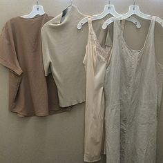 a photo of several brown shirts and tank tops hanging on hangers