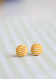 I want these!  Yellow button earrings from shopruche.com
