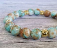 Mottled Glass Stackable Bracelet in Blue, Brown and Gold // Stretch Bracelet // Summer Jewelry // Earth Tone Beads on Etsy, $22.00