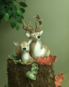 Buck & Doe Deer Head Groom's Cake  Chocolate Fudge cake with Chocolate Buttercream frosting to resemble stacked Tree Stump Slices. My Groom's Cake with Fondant Fall Leaves and Fondant Buck and Doe toppers. Not easy to make but turned out beautiful on the cake. (Sorry pictures are a little blurry)